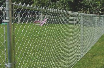 brand-new-galvanized-chain-link-fence-in-backyard