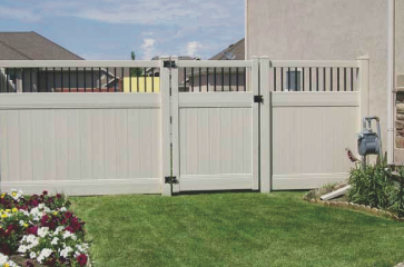 custom-almond-vinyl-fence-with-4-foot-gate-on-side-of-home