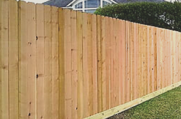 wood-fence-with-natural-stain-fence-repair-after-wooden-panels-fell-off