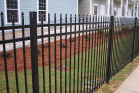 Ornamental fences come in steel or aluminum with the look of wrought iron. This is a great fence if you are looking to add value and security to your home. They create a beautiful boundary around a pool, front or back yard, and have limited to no maintenance.