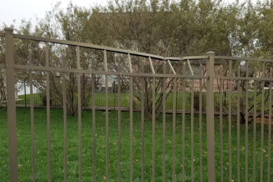 top-of-brown-aluminum-fence-is-leaning-over-and-broken-and-needs-replaced